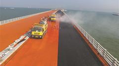 世界最大规模钢桥面铺装工程 规模达70万平方米