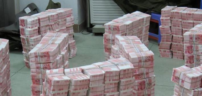粤警方缴2.14亿假币堆起有66层楼高
