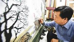 我与海南30年30人  海南本土画家邓子芳把海南山水画进人民大会堂