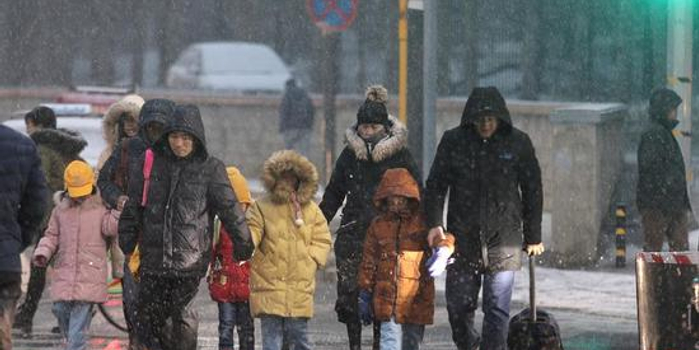 北京城區雪還在下 預計全市能達中到大雪量級(圖)