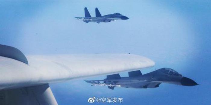 连续两日绕台后 空军发布歼11轰6K挂弹飞行画面