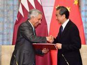 王毅同卡塔尔外交国务大臣签署中卡互免签证协定