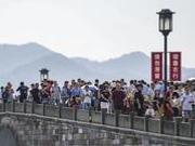 """国庆旅游出现景点""""打卡""""新方式:叫外卖"""
