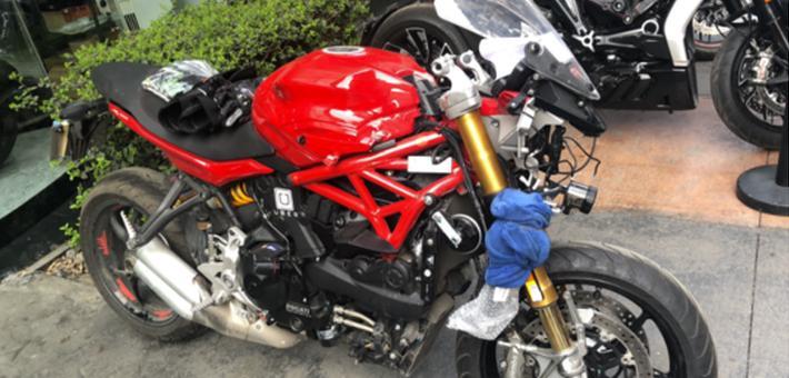 15万进口摩托车被4S店偷拆零件