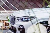 城市光影流动,全新BMW X5冬日下江南