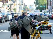 费城枪击案:警方耽心人质劫持 行凶枪手仍未克制钦敬