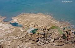 Sinkholes seen on shore of Dead Sea as water level decreases