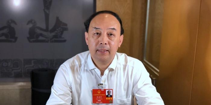 周洪宇代表:建議實施殘疾學生15年免費教育