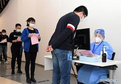 Company staff receive COVID-19 vaccines in Haidian District of Beijing
