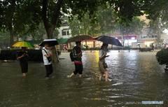 Record rains hit Henan, C China