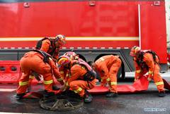 Rescue team of 1,800 firefighters deployed to flood-hit Henan from 7 neighboring provinces