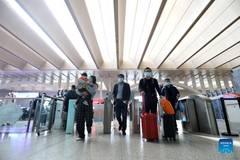 Transportation hubs across China witness peak of return passengers