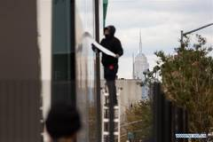 Workers board up stores to protect themselves against looting in NY