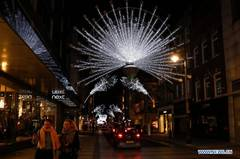 Christmas lights shine in central London, Britain