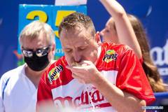 Defending champion breaks record by eating 76 hot dogs in New York
