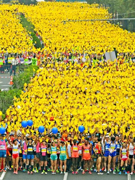 男女亚军分别由都是第一次参加全程马拉松的日本选手八木勇树,新立启