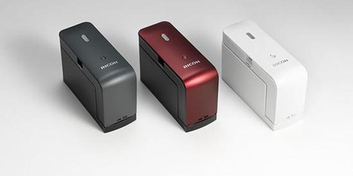 真钱炸金花_理光推出一款能带出门的打印机 滑动就能打印