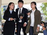 韩国男星胜利涉嫌海外赌博再次现身警局接受调查
