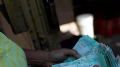 委内瑞拉搏命式自救:拿着 这是新货币!