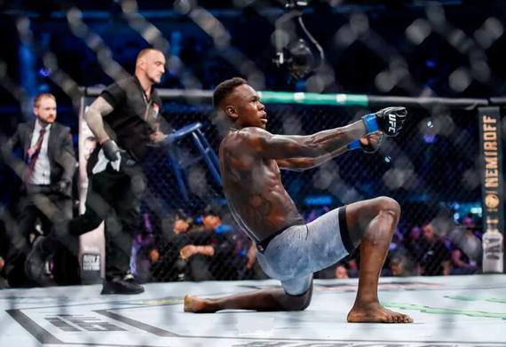 阿迪萨亚击败维泰克尔统一了UFC中量级冠军头衔