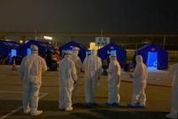昨天凌晨26名境外返杭旅客統一接回杭州 22人接受隔離