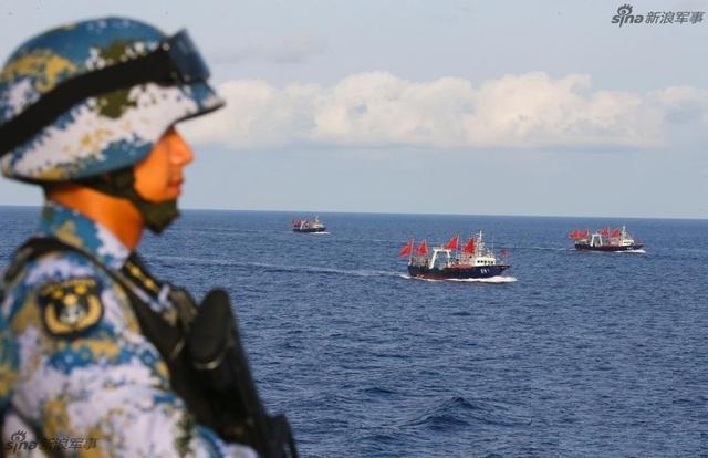 我六千吨军舰为百吨渔船护航