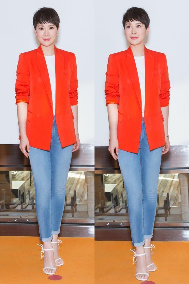 """荷兰国家旅游局宣布海清出任""""荷兰旅游大使""""。海清身穿代表荷兰颜色的橙色外套出席(外套来自Stella McCartney),造型选择心思细腻。"""