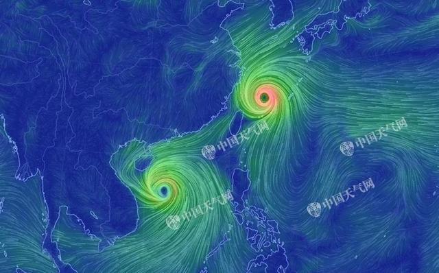 """台风""""泰利""""(右上)和""""杜苏芮""""(左下)相继生成,虽然双台风不登陆我国,但对华东、华南沿海的风雨影响仍不容小觑。换个角度看双台风!图为双台风流场图,图中线条代表风力,颜色越暖说明风力越大。图中可见,台风中心风力强劲。"""