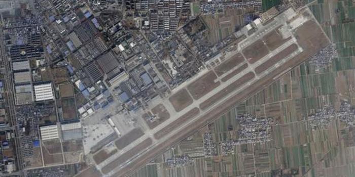 美卫星曝光西飞机场:停满20架运20和17架轰6(图)