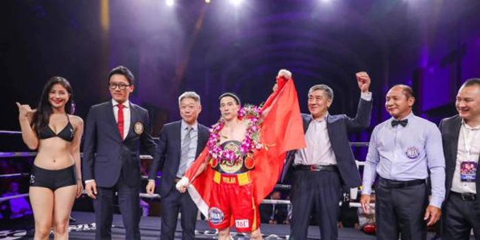 中日拳手激戰上海灘 烏蘭KO對手奪世界冠軍挑戰權